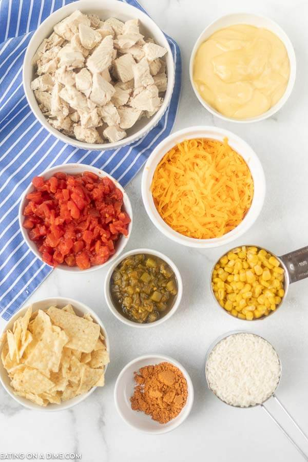 Ingredients for recipe: chicken, cream of chicken, cheese, diced tomatoes, corn, seasoning, tortilla chips.